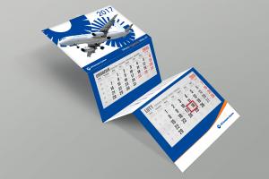 Kalendarz trójdzielny firmowy z wypukłą główką niebieski z samolotem
